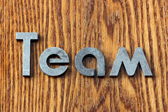 Team. Word team of iron letters Stock Image