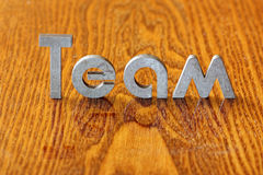 Team. Word team of iron letters Stock Photography