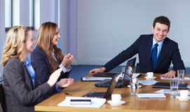 Team of 3 business people sitting at table Royalty Free Stock Image