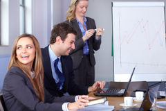 Team of 3 young businesspeople during meeting Stock Photo