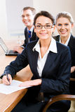 Team. Image of business team with leader in front sitting at the table Royalty Free Stock Photos