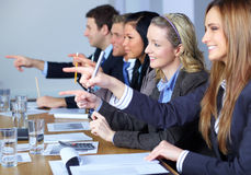 Team of 5 business people point forward Stock Photo