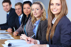 Team of 5 business people working on paperwork Stock Photos