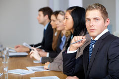 Team of 5 business people with young male at front Stock Image