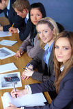 Team of 5 businesspeople working on paperwork Royalty Free Stock Image