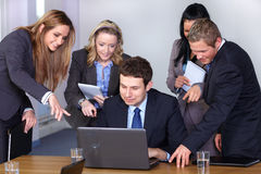 Team of 5 young businesspeople, conference room Royalty Free Stock Photography