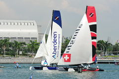 Team Aberdeen Singapore racing Alinghi at Extreme Sailing Series Singapore 2013 Royalty Free Stock Photo