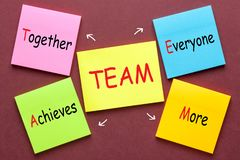 Team Acronym Concept. Together Everyone Achieves More Team acronym written on color notes stock photos