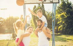 Team against the team, who is the winner?. Family playing basketball. Close up stock photography