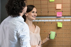 Team of agency employees in time scheduling meeting Royalty Free Stock Photos