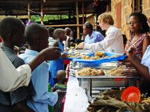 Team aid relief volunteers workers feeding hungry children Africa