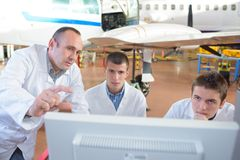 Team aircraft engineers repairing parts jet. Team of aircraft engineers repairing parts of jet Royalty Free Stock Image