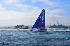 Team AkzoNobel Passes A Navy Ship Volvo Ocean Race Alicante Royalty Free Stock Photography