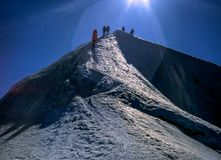 Team of alpinists on a mountain top Royalty Free Stock Image