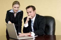 Team analysis. Attractive and sobre business woman and her elegant boss during a team analysis Royalty Free Stock Image