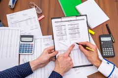 Team analyzes the business expenses of the annual budget. royalty free stock image