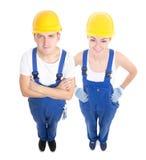 Team arbetsbegreppet - stilig man och härlig kvinna i blå bui Arkivfoton