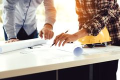 Team architect or engineering people standing working on table t royalty free stock photography