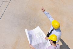 Team of architects on construciton site Royalty Free Stock Photo