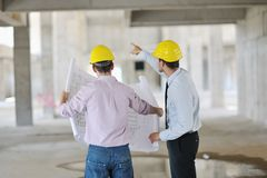 Team of architects on construciton site royalty free stock images