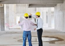 Team of architects on construciton site stock images