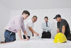Team of architects on construciton site royalty free stock photography