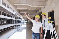 Team of architects on construciton site Stock Image