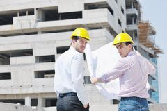 Team of architects on construciton site Stock Photo