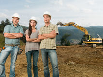 Team of architects on construction site Stock Photo