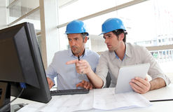 Team of architects in front of desktop Royalty Free Stock Photos