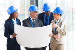 Team architects interacting Royalty Free Stock Photo