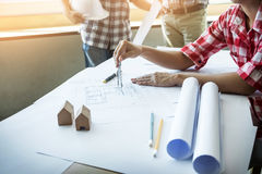 Team of architects people in group on construciton site check do Stock Photography