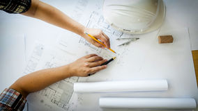 Team of architects people in group on construciton site check do Royalty Free Stock Photo