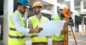 Team of architects people in group on construciton site. Check documents royalty free stock photography