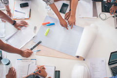 Team of architects people in group on construciton site check documents workflow Stock Image