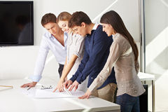 Team of architects working. Together on building plan in an office Stock Photo