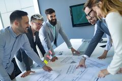 Team of architects working on construction plans. Together stock photos