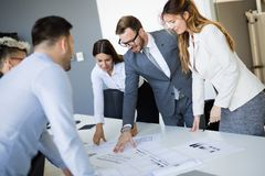 Team of architects working on construction plans. Together stock image