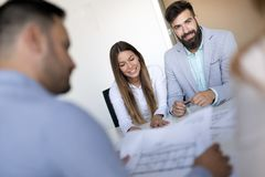 Team of architects working on construction plans. Together royalty free stock photography