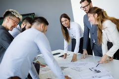 Team of architects working on construction plans Royalty Free Stock Image