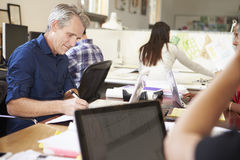 Team Of Architects Working At Desks In Office Stock Photography