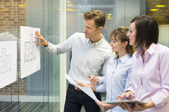 Team of architects working in office on construction project Royalty Free Stock Photo