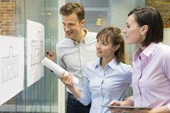 Team of architects working in office on construction project Royalty Free Stock Images
