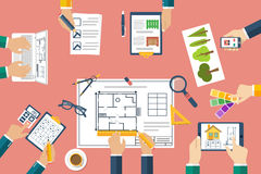 Team of architects working on a project. Architects discussing p. Lans. Hands of architects working on blueprints. Teamwork, brainstorming. Work Desk designers Royalty Free Stock Photos