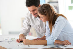 Team of architects working on a project. Team of architects working together on project Royalty Free Stock Photo