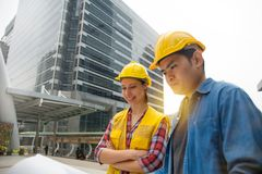 Team of architectures standing at construction site looking at p. Rogress Stock Image