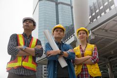 Team of architectures standing at construction site looking at p. Rogress Royalty Free Stock Photos