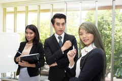 Team of Asian business posing in meeting room at office. Working brainstorming at spacious board room at the office. Asian royalty free stock photos
