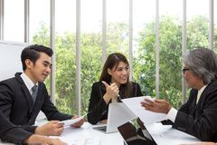 Team of asian business posing in meeting room. Working brainstor royalty free stock photo