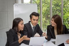 Team of asian business posing in meeting room. Working brainstorming at spacious board room at the office. asian people royalty free stock photography